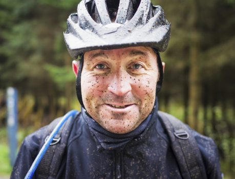 Cyclist with mud on his face