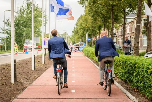 Cyclist rides on the worlds first fully recycled plastic cycle path in Amsterdam
