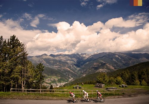 Cyclists ride along the mountains of Andorra