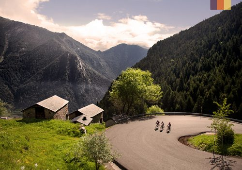Cyclists ride through the mountains of Andorra