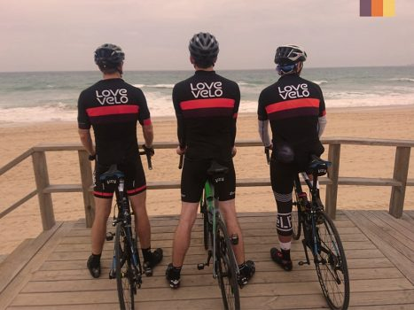 3 Cyclists looking at the beach