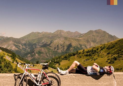 Cyclist takes a break at the top of the Pyrenees