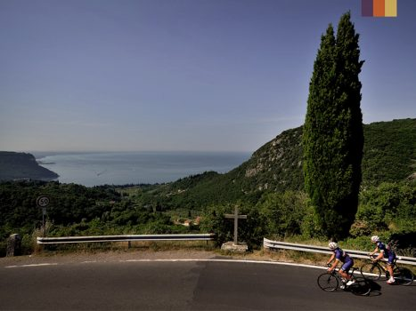 Cyclists ride at the Lake Garda