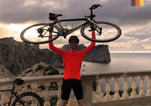Cyclist at the Cap Formentor Lighthouse