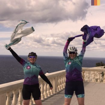 Two women celebrate reaching the cap formentor lighthouse in Mallorca