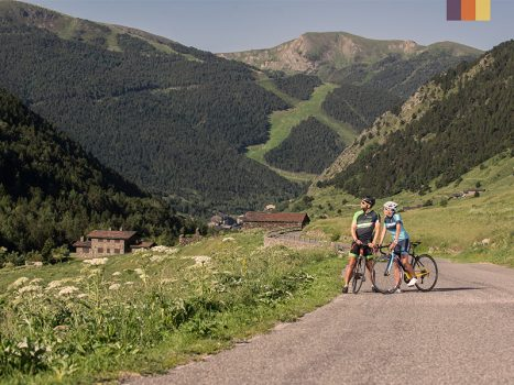 Two cyclists taking a picture in Andorra