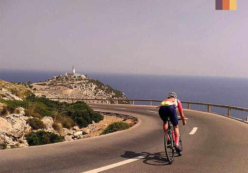 Cycling along the coast to Cap Formentor lighthouse in Mallorca