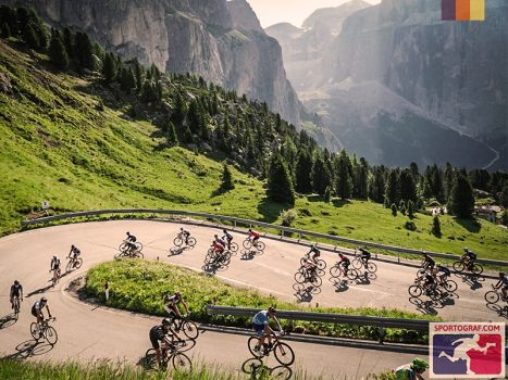 Cyclists cycling up switchbacks in Maratona Dles Dolomites, Italy