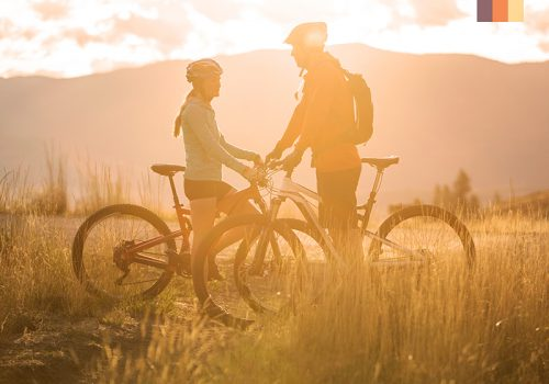 Couple take a break from cycling in the countryside