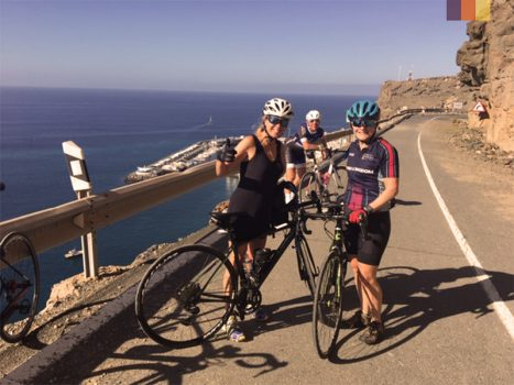 cyclists on a coastal road in gran canaria next to the beach whilst cycling in the canary islands