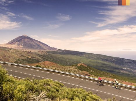 Mount teide volcano in tenerife with cyclists cycling in the canary islands