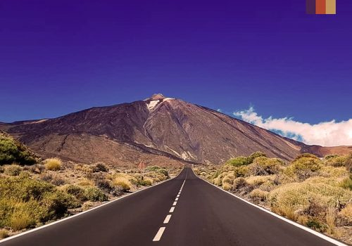 tarmac road leading up to mount teide in tenerife