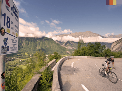 a switchback bend on the alpe d'huez climb in france overlooking the alps mountains