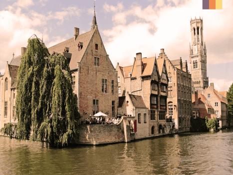 belfry of burges tower beside the river in belgium