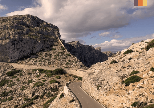 a switchback road with steep drops in the tramuntana mountains in mallorca