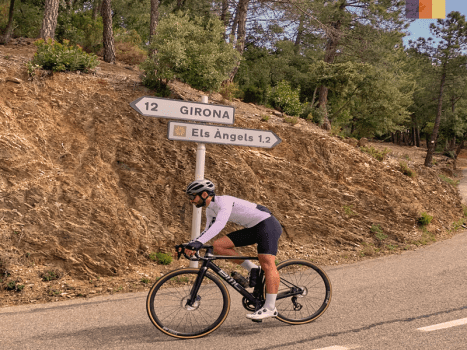 road cyclist cycling on a switchback whilst tackling the els angels climb in girona