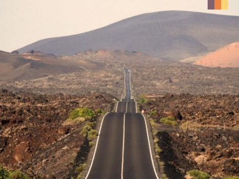 an expansive landscape with undulating road in the timanfaya national park in lanzarote