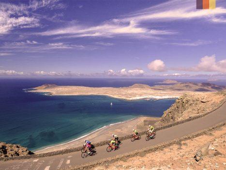 road cyclists on a coastal road at the mirador del rio in lanzarote