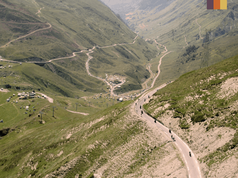 col du tourmalet cycling climb in the pyrenees surrounded by forested mountains