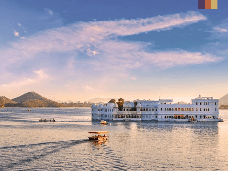 a boat travels to the lake palace on lake pichola in udaipur