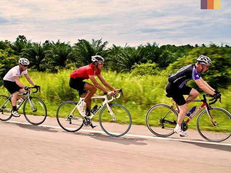 road cyclists on the ho chi minh highway in vietnam
