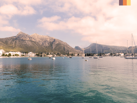 view of the port pollensa bay in mallorca with blue sea and tramuntana mountains