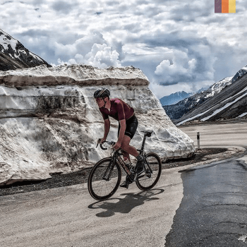 a road cyclist surrounded by snow whilst winter cycling in livigno