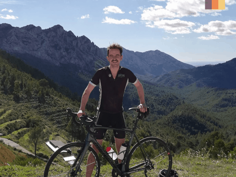 a love velo cyclist on a mountainous cycling route in sierra nevada, spain