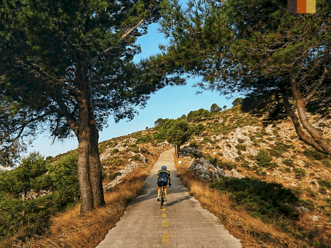 a road cyclists cycling the hidden section of the coll de rates climb in costa blanca, spain