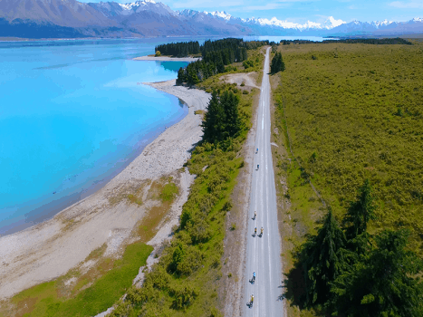 birds eye view of the alps to ocean cycle trail in new zealand with snow capped mountains and glacier lakes