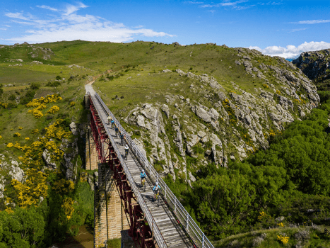 the otago rail trail built for cycling in new zealand on disused railways in the mountainous countryside