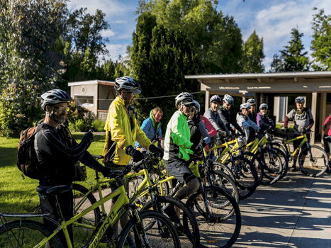 a group of cyclists ready to begin their guided trip cycling in new zealand