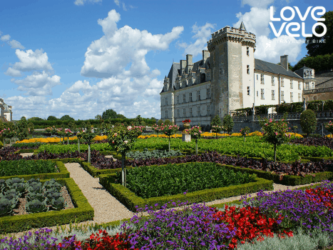 a traditional chateau set in a floral garden in the loire valley, france