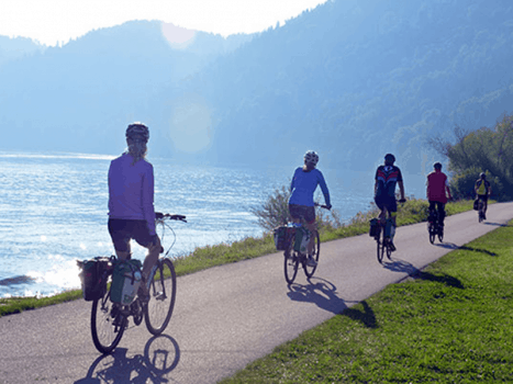 a group of cyclists are cycling on the danube river cycle path in hungary on an activity holidays for adults