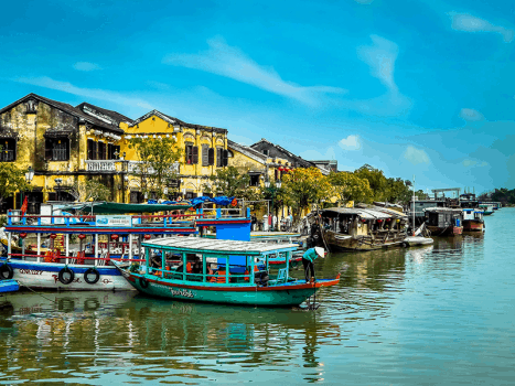 a colourful boat sits on the river in the historic hoi an in vietnam