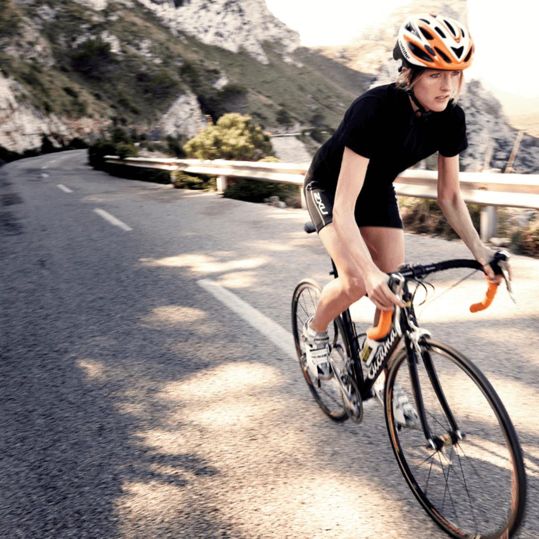Love Velo cyclist riding up the Coll de Sa Creueta