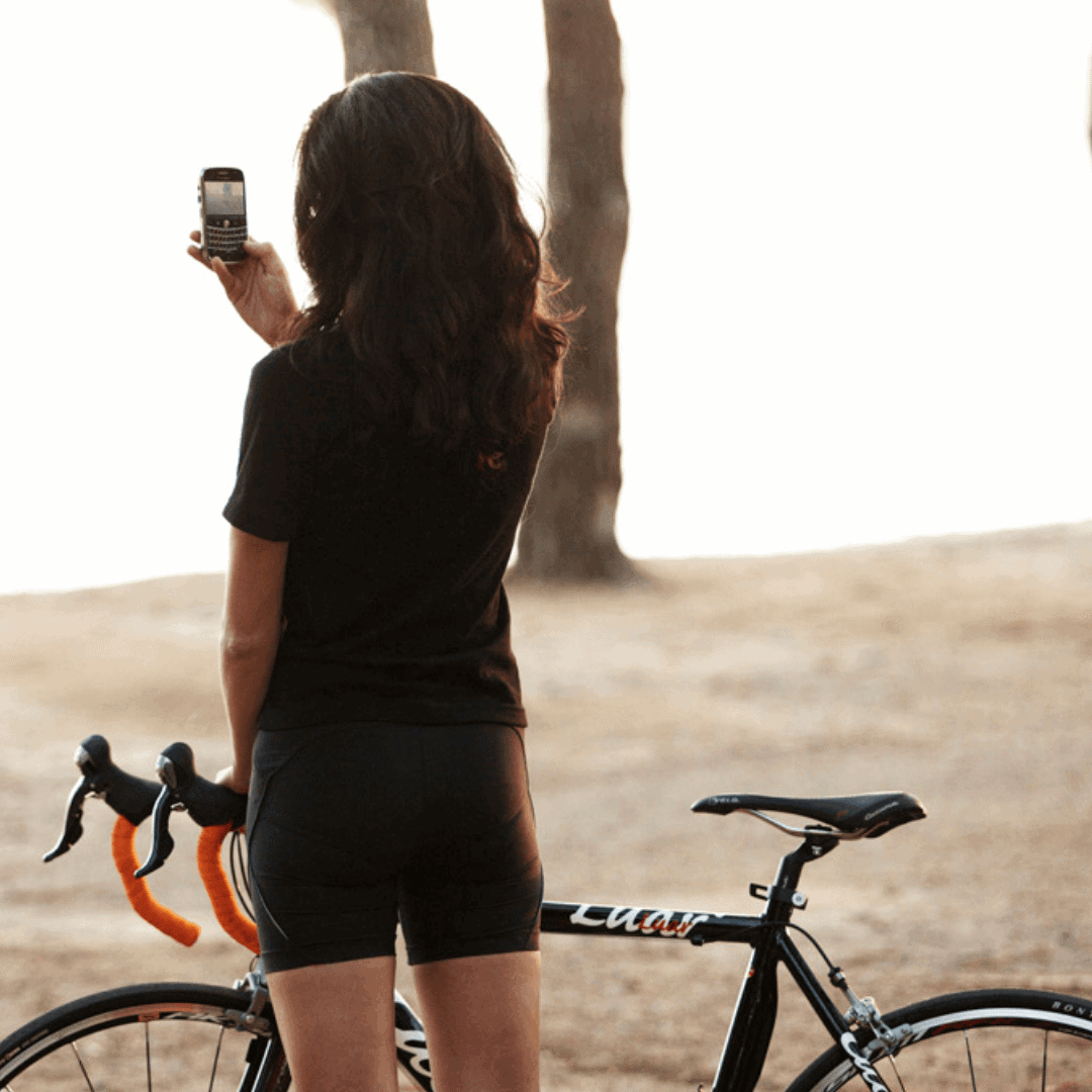 Cyclist taking picture at Formentor Beach