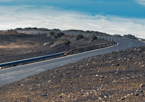 2 cyclists cycling up a road on Mount Teide in Tenerife