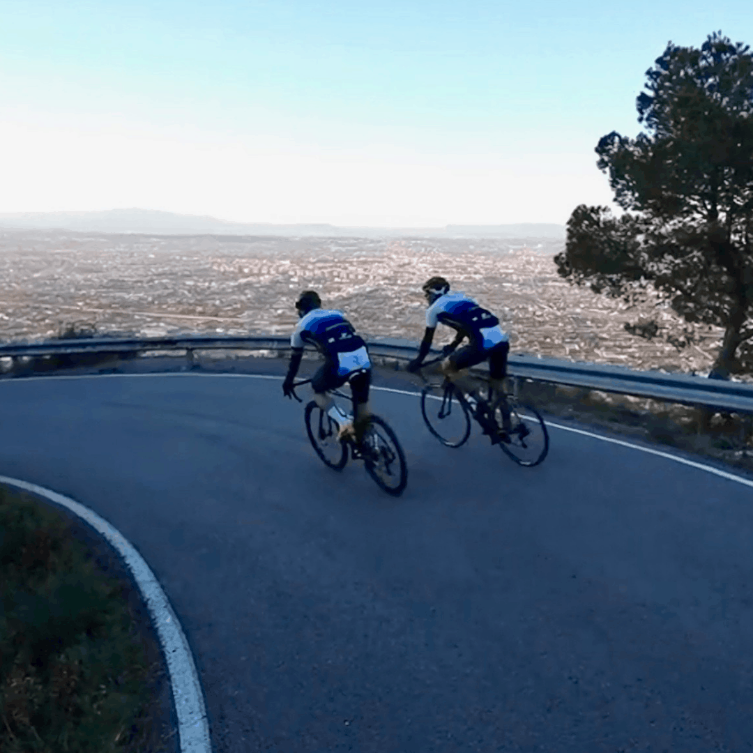 2 cyclists descending a traffic free road in Murcia
