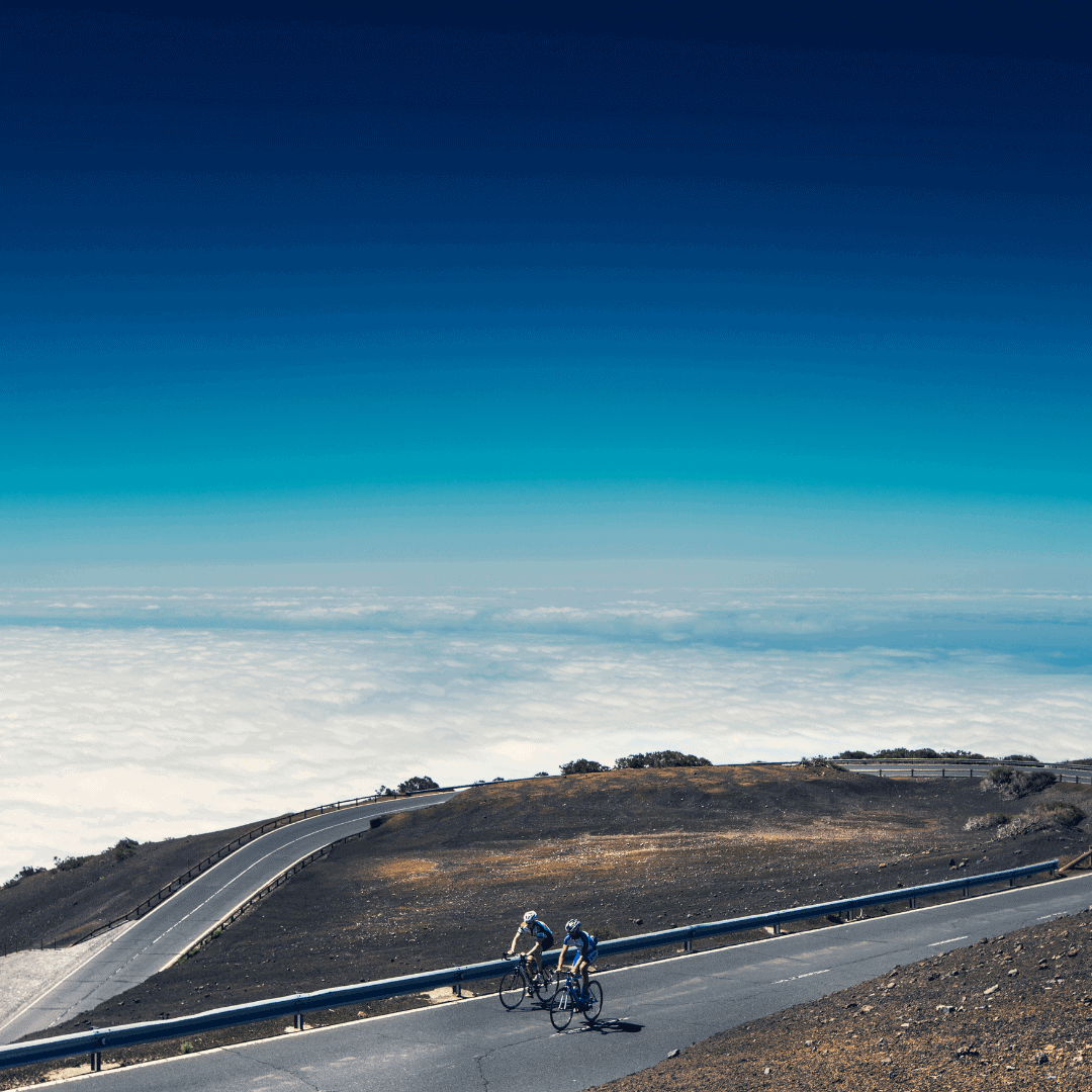 2 Cyclists Riding up Mount Teide in Tenerife