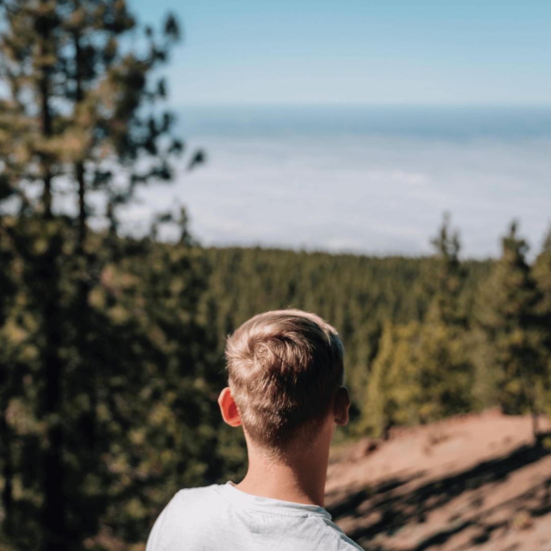 A young man looking out over Tenerife from Mount Teide