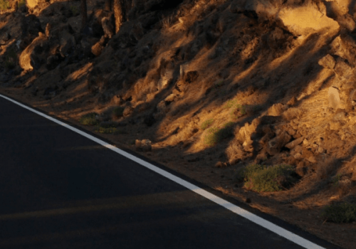 Jet Black tarmac road leading up to Mount Teide in Tenerife