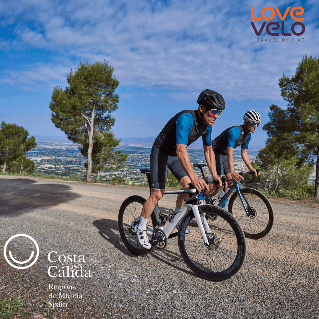 2 cyclists climbing up the Cabeza de la Plata in Murcia