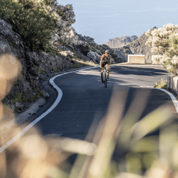 A rider cycling in Tenerife up a climb