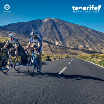 2 riders cycling in Tenerife with Mount Teide in the background
