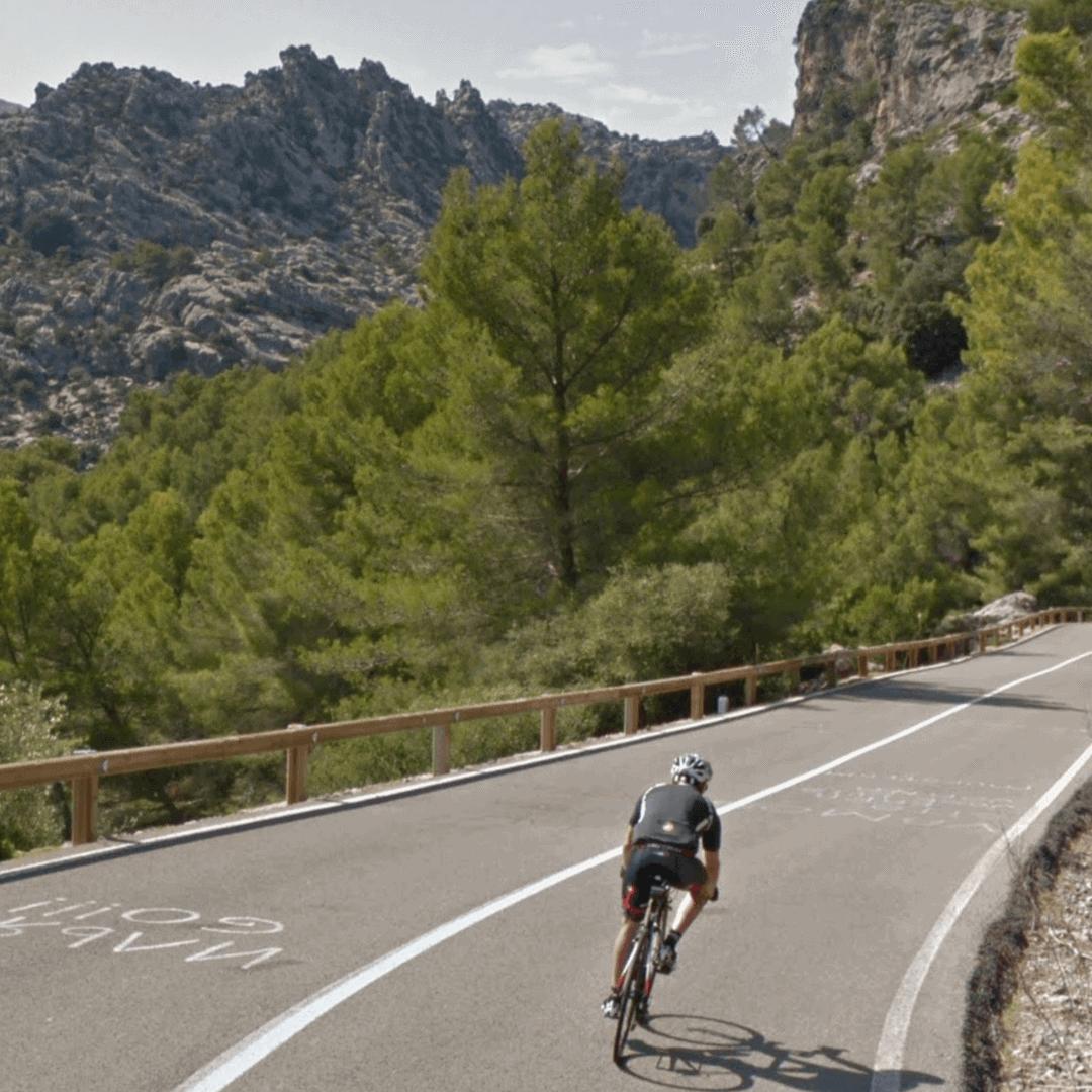 Cyclist riding down the COll de Femenia in Mallorca